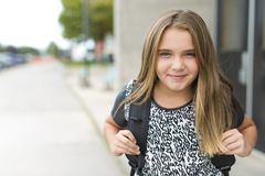 Elementary school pupil outside carrying rucksack Stock Photos