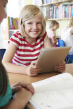 Elementary School Pupil Using Digital Tablet In Classroom Royalty Free Stock Photos