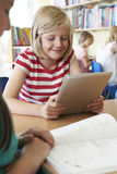 Elementary School Pupil Using Digital Tablet In Classroom Stock Images