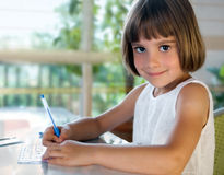 Elementary school pupil writing Royalty Free Stock Photography
