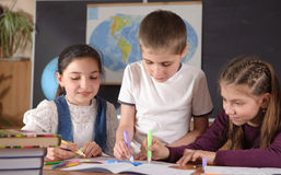 Elementary school pupils stock images
