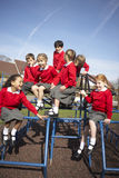 Elementary School Pupils On Climbing Equipment Royalty Free Stock Photography