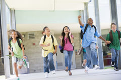 Elementary school pupils running outside Royalty Free Stock Photos