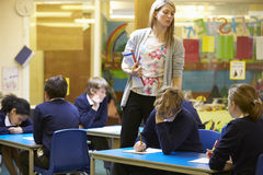 Elementary School Pupils Sitting Examination In Classroom Royalty Free Stock Images