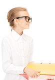 Elementary school student with folders Royalty Free Stock Photos