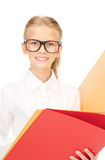 Elementary school student with folders Royalty Free Stock Images