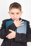 Elementary school student with his favorite book Stock Images