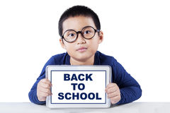 Elementary school student with tablet back to school Royalty Free Stock Photo
