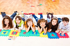 Elementary school students. Six elementary school students with puzzled numbers Stock Photo