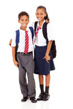 Elementary school students. Two elementary school students full length isolated on white Stock Photos
