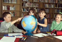 Elementary school students studying. In library royalty free stock images