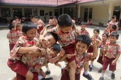 Elementary school students were playing. Elementary school students in Singkawang, West Kalimantan, Indonesia, were playing in school yard Royalty Free Stock Images