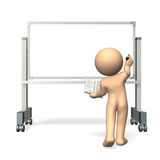 Elementary school students write on the whiteboard Stock Images