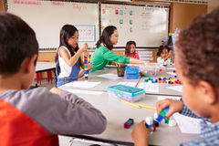 Elementary school teacher uses block play in class with kids Royalty Free Stock Photo