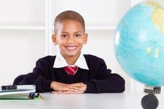 Elementary schoolboy. Cute elemantary schoolboy in classroom Royalty Free Stock Photos