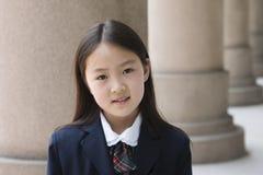 Elementary schoolgirl. 9 year old elementary schoolgirl in school uniform Stock Image