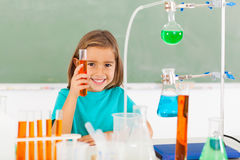 Elementary schoolgirl lab. Cute elementary schoolgirl at the lab holding a tube with liquid Stock Image
