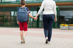 Elementary student boy with mother going to school Royalty Free Stock Images