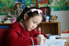 Elementary student doing homework royalty free stock photo