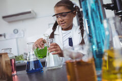 Elementary student doing scientific experiment at laboratory Stock Images