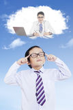Elementary student imagining his dream Stock Photos