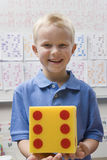 Elementary Student with Large Dice Stock Photography