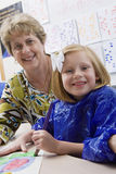 Elementary Student Painting With Teacher In Class Stock Photography
