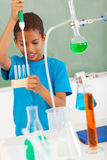 Elementary student science. Cute elementary school student in science class Stock Photos