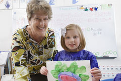 Elementary Student Showing Her Painting Stock Photos