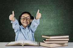 Elementary student showing ok sign Stock Photography