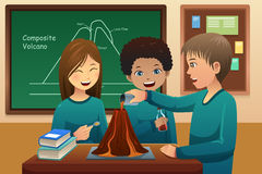 Elementary students doing a volcano experiment Royalty Free Stock Images
