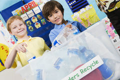 Elementary Students With Recycling Container Royalty Free Stock Photography