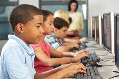 Elementary Students Working At Computers In Classroom Royalty Free Stock Photography