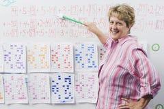 Elementary Teacher Teaching Arithmetic Stock Images
