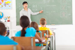 Elementary teaching chinese. Elementary school teacher teaching chinese language in classroom stock photography