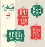 Elementi d'annata di progettazione di tipografia delle etichette del regalo di festa di Natale Immagine Stock