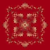 Elemento barroco de oro en fondo rojo Foto de archivo libre de regalías