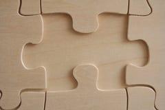 Elemento di legno del puzzle immagini stock