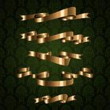 Elemento real dourado da fita no teste padrão verde Imagens de Stock