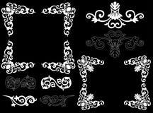 Elementos blancos del diseño en un fondo negro Fotos de archivo libres de regalías