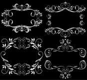 Elementos blancos del diseño en un fondo negro Fotos de archivo