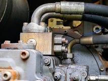Elementos da construção da máquina escavadora vestida velha fotografia de stock