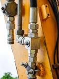 Elementos da construção da máquina escavadora vestida velha imagens de stock royalty free