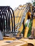 Elementos da construção da máquina escavadora vestida velha imagem de stock royalty free