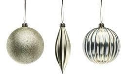 Elementos de plata de la decoración de la Navidad aislados en el backgroun blanco Foto de archivo libre de regalías