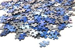 Elementos de un rompecabezas azul Fotografía de archivo