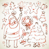 Elementos desenhados mão do Natal Fotos de Stock Royalty Free