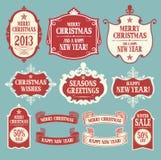 Elementos do projeto do Natal. Crachás, etiquetas e ribb Imagens de Stock