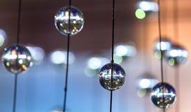 Elementos esféricos de cristal del diseño en cuerdas Imágenes de archivo libres de regalías