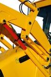 Elementos hidráulicos de la niveladora universal del color amarillo Imagenes de archivo